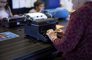 A visitor uses a typewriter