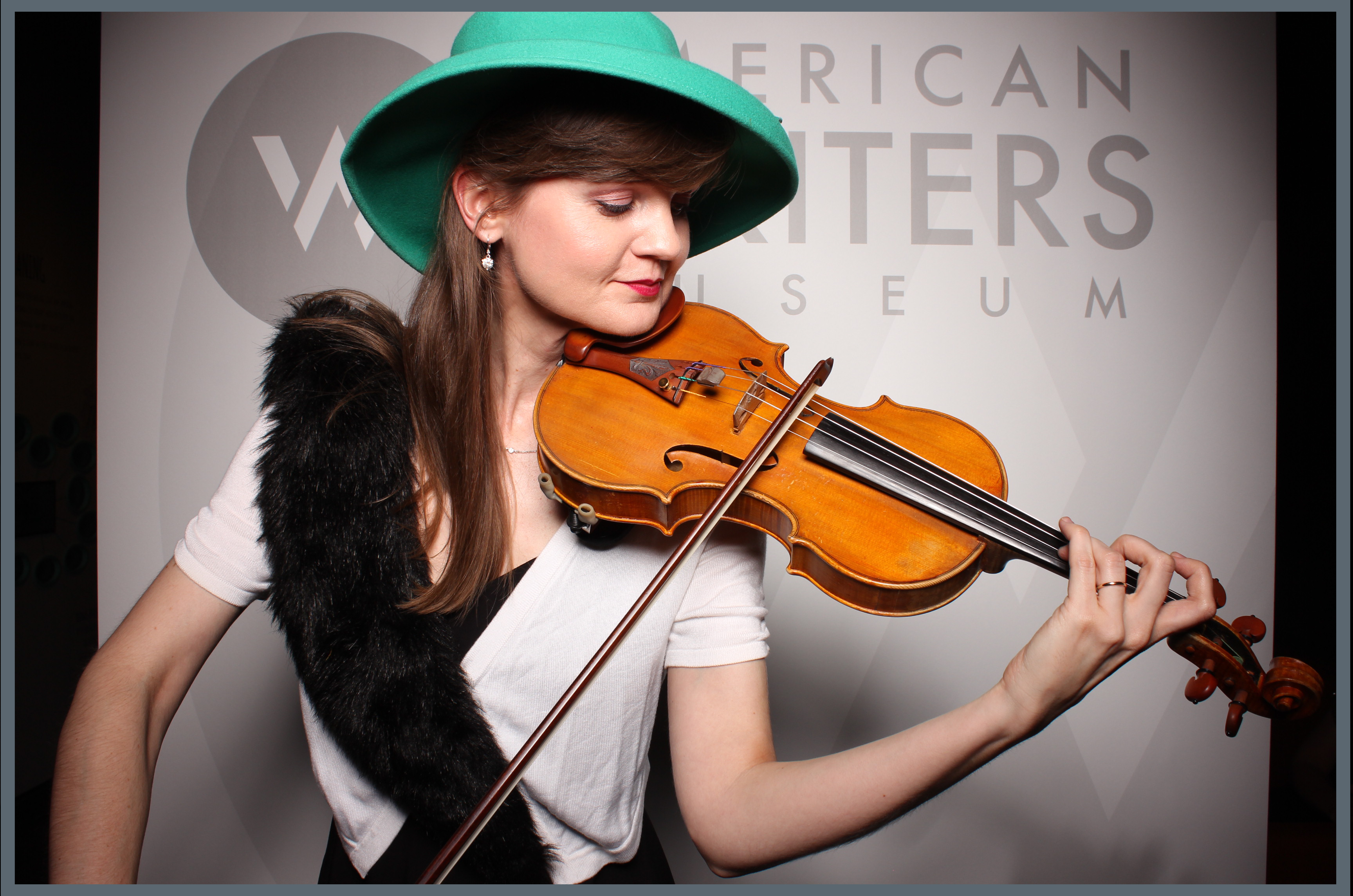 Portrait of a violin player at the American Writers Museum
