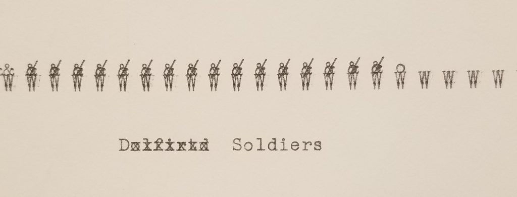 typewritten soldiers created with a capital w and & symbol