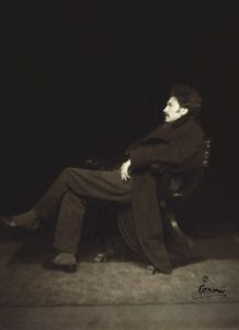 Ezra Pound seated profile
