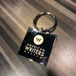 Silver logo American Writers Museum keychain