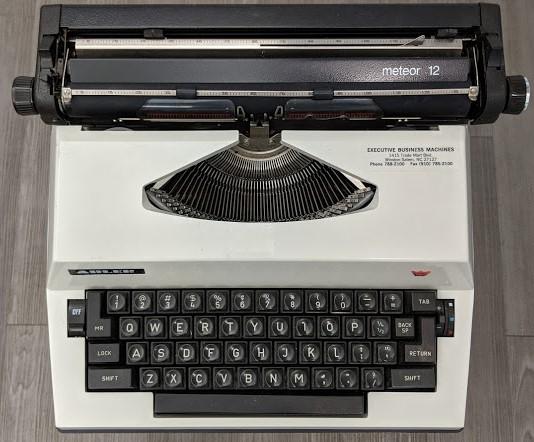 Top-down image of Maya Angelou's Meteor 12 typewriter on display at the American Writers Museum